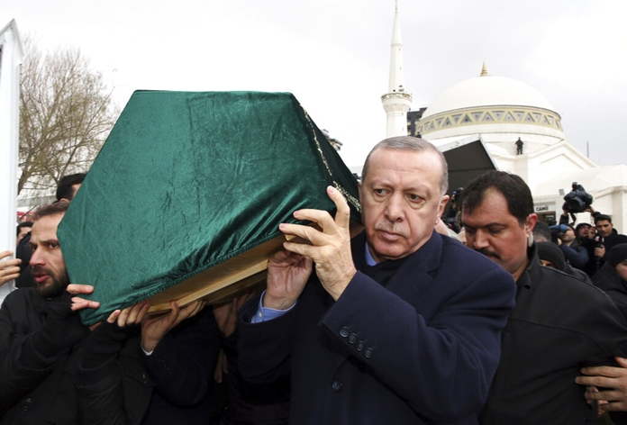 Turkey's President Recep Tayyip Erdogan, center, carries a coffin as he joins hundreds of mourners who attend the funeral prayers for nine members of Alemdar family killed in a collapsed apartment building, in Istanbul, Saturday, Feb. 9. (Presidential Press Service via AP, Pool)