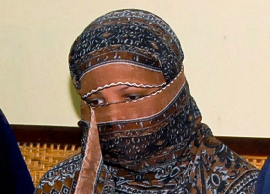 In this Nov. 20, 2010, file photo, Asia Bibi, a Pakistani Christian woman, listens to officials at a prison in Sheikhupura near Lahore, Pakistan. (AP Photo)