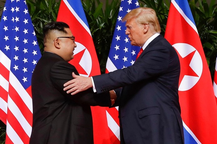 In this June 12, 2018 file photo, President Donald Trump shakes hands with North Korea leader Kim Jong Un at the Capella resort on Sentosa Island in Singapore. (AP Photo/Evan Vucci)