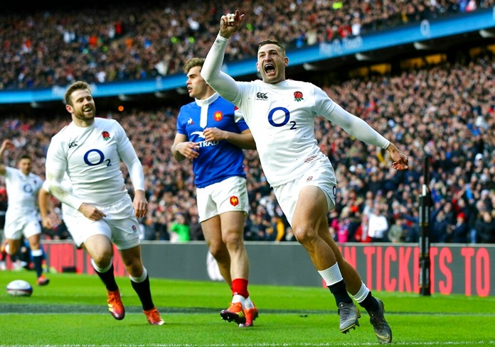 England's Jonny May celebrates scoring is team's first try of the game during the Six Nations rugby union match against France, at Twickenham Stadium, London, Sunday Feb. 10. (Gareth Fuller/PA via AP)