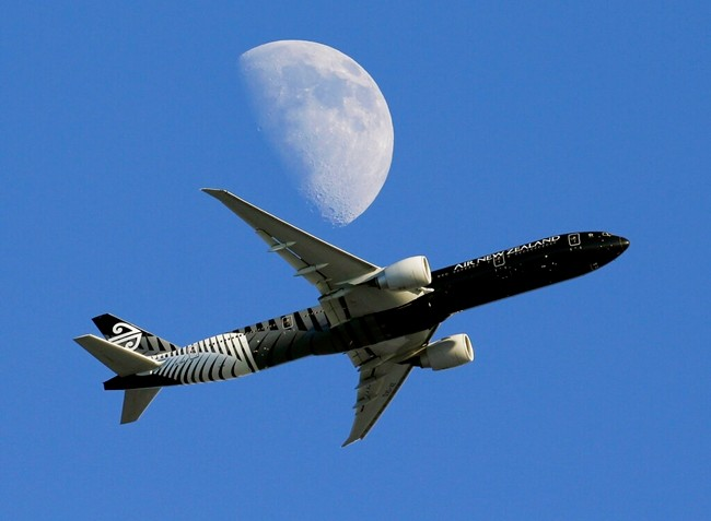 In this Aug. 23, 2015, file photo, an Air New Zealand passenger plane flies past the moon on its way to the Los Angeles International Airport. (AP Photo/Nick Ut)