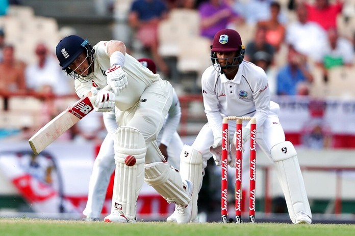 England captain Joe Root plays a shot against West Indies during day three of the third cricket Test match at the Daren Sammy Cricket Ground in Gros Islet, St. Lucia, Monday, Feb. 11. (AP Photo/Ricardo Mazalan)