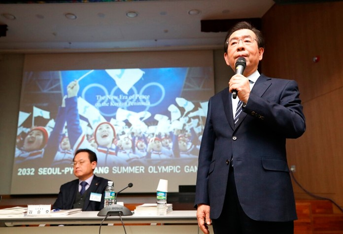Seoul Mayor Park Won-soon, right, speaks during the Korean Sport & Olympic Committee general assembly at the National Training Center in Jincheon, South Korea, Monday, Feb. 11. (Kim In-chul/Yonhap via AP)