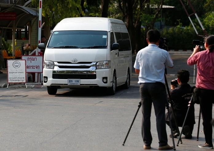 A van believed to be carrying refugee soccer player Bahraini Hakeem al-Araibi leaves a prison, Monday, Feb. 11, in Bangkok. (AP Photo/Sakchai Lalit)