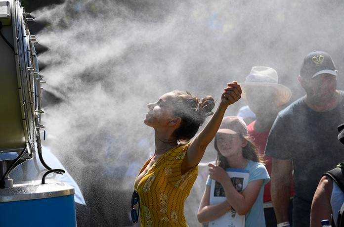 Australia sweltered through its hottest month on record in January and the summer of extremes continues with wildfires razing the drought-parched south while expanses of the tropical north are flooded. (AP Photo/Andy Brownbill, File)