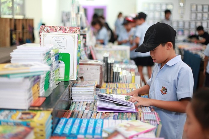 A Primary student browses the books.