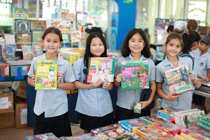 These four students picked up some bargains during Primary Book Week.