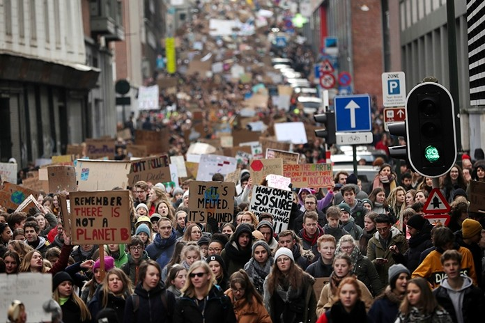 Thousands of youngsters crowd the streets as they march during a climate change protest in Brussels, Thursday, Jan. 31, 2019. Thousands of teenagers in Belgium have skipped school for the fourth Thursday in a row in an attempt to push authorities into providing better protection for the world's climate. (AP Photo/Francisco Seco)