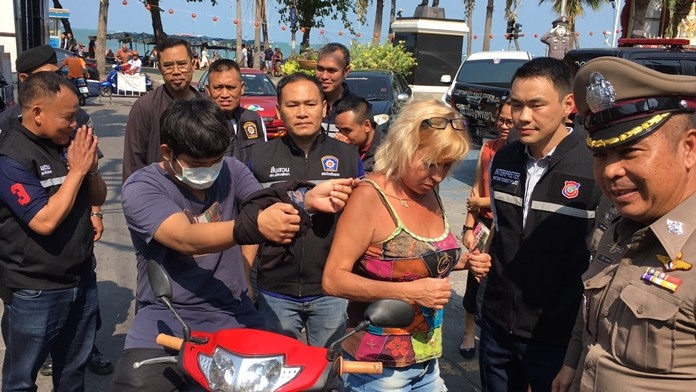 Pittaya Darin reenacts the crime for the cameras. He was arrested at his Soi Nonghin apartment after he allegedly snatched Russian tourist Valentina Mzheenko's gold necklace.