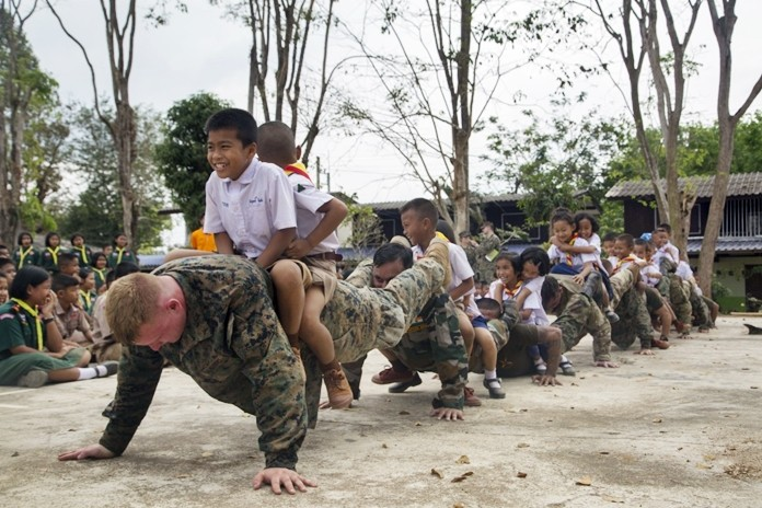 U.S., Indian, and Royal Thai service members and students at the Ban Wang Mai Daeng School participate in a group push-up activity during Cobra Gold 19 at Ban Wang Mai Daeng School, Chanthaburi, Feb. 6, 2019. (U.S. Marine Corps photo by Lance Cpl. Kenny Nunez.)