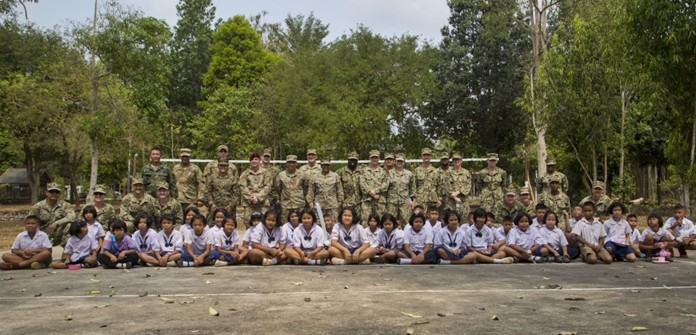 U.S. and Royal Thai service members and students from the Ban Man Kroi School come together for a group photo during exercise Cobra Gold 19 at Ban Man Kroi School, Rayong, Feb. 5, 2019. (U.S. Marine Corps photo by Lance Cpl. Kenny Nunez.)