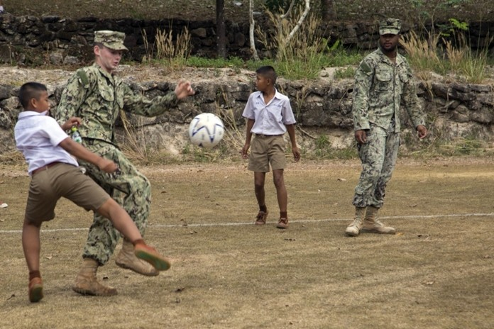 U.S. Navy service members and students from the Ban Man Kroi School play soccer together during exercise Cobra Gold 19 at Ban Man Kroi School, Rayong, Feb. 5, 2019. (U.S. Marine Corps photo by Lance Cpl. Kenny Nunez.)