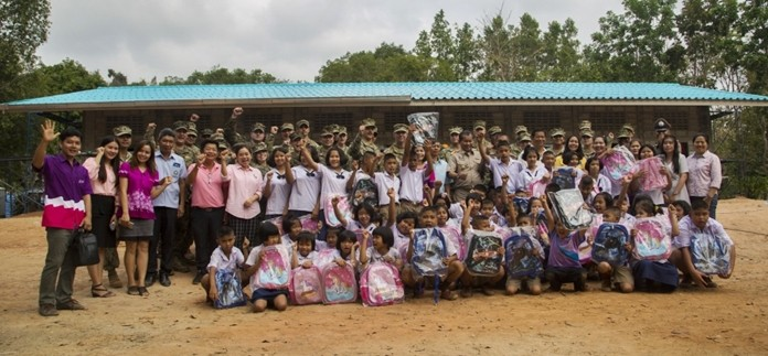 U.S. and Royal Thai service members along with staff and students from the Ban Man Kroi School come together for a group photo during exercise Cobra Gold 19. The students were excited to receive new backpacks from U.S. service members. (U.S. Marine Corps photo by Lance Cpl. Kenny Nunez.)