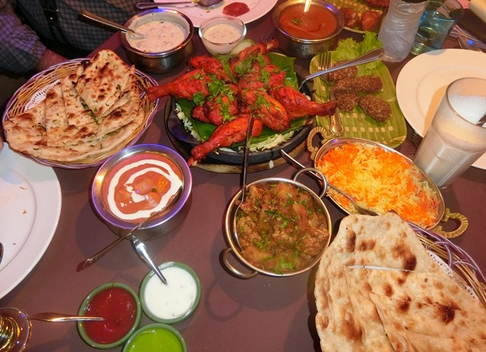 Indian dining is a 'family' affair, the table was bedecked with delightful curries and nans.