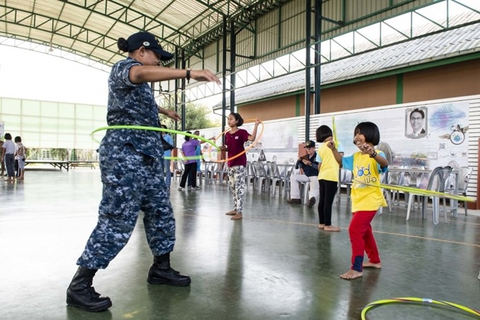 Operations Specialist Seaman Catherina Watson, from Jacksonville, Fla., hula hoops with a child during a community service project at the Child Protection and Development Center in Chonburi.
