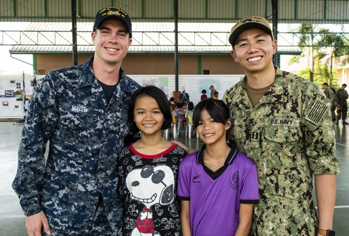 Seaman Preston Mayer, left, and Lt. Michael Siy, right, both from Fresno, Calif., pose for a photo during a community service project at the Child Protection and Development Center in Chonburi.