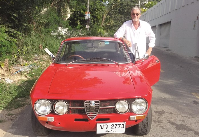 Jo Klemm, founder and president of the Classic Car Friends Pattaya, poses with his prized Alpha Romeo.