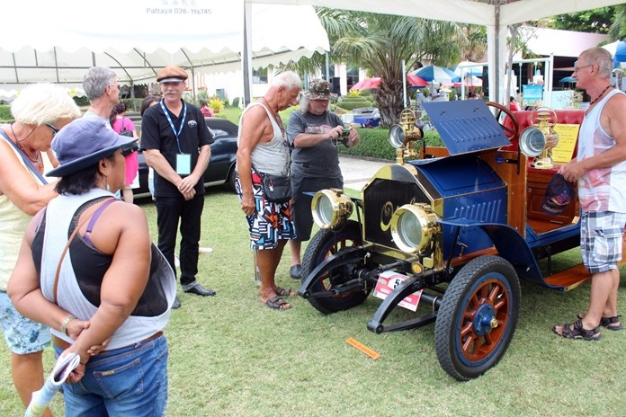 Vintage cars always attract a hoard of admirers.