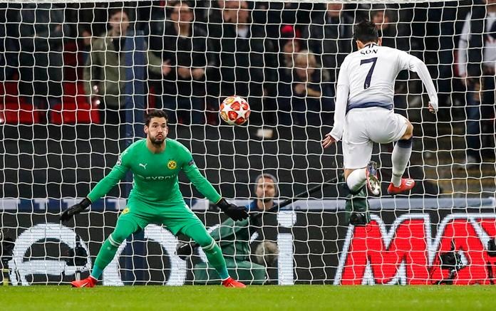 Tottenham midfielder Heung-Min Son, right, scores the opening goal against Borussia Dortmund at Wembley stadium in London, Wednesday, Feb. 13. (AP Photo/Frank Augstein)