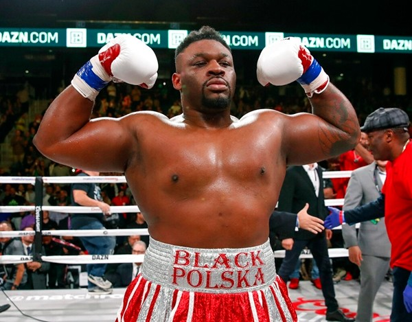 In this Oct. 8, 2018, file photo, Jarrell Miller celebrates after defeating Tomasz Adamek, of Poland, in a heavyweight boxing match in Chicago. (AP Photo/Kamil Krzaczynski)