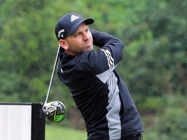 Sergio Garcia, of Spain, drives on the second tee in the rain in the Pro-Am round of the Genesis Open golf tournament at Riviera Country Club in the Pacific Palisades area of Los Angeles Wednesday, Feb. 13. (AP Photo/Reed Saxon)