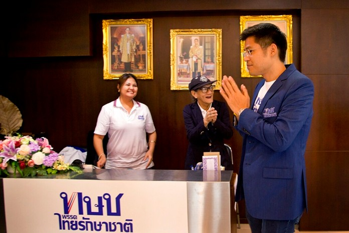 The leader of the Thai Raksa Chart political party Preechapol Pongpanich, right, greets officials at party head-office in Bangkok, Wednesday, Feb. 13. (AP Photo/Gemunu Amarasinghe)