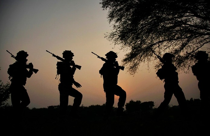 In this Oct. 2, 2016 file photo, Indian army soldiers patrol near the Line of Control in Nowshera sector, about 90 kilometers from Jammu, India. (AP Photo/Channi Anand)