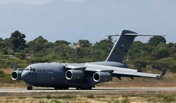 A United States Air Force C-17 cargo plane loaded with humanitarian aid lands at Camilo Daza airport in Cucuta, Colombia, Saturday, Feb. 16. (AP Photo/Fernando Vergara)