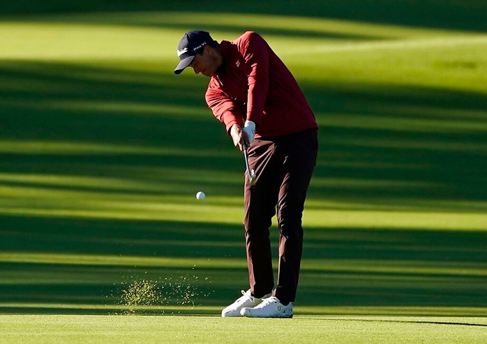 Adam Scott, of Australia, hits his second shot on the ninth hole during the second round of the Genesis Open golf tournament at Riviera Country Club on Saturday, Feb. 16, in the Pacific Palisades area of Los Angeles. (AP Photo/Ryan Kang)