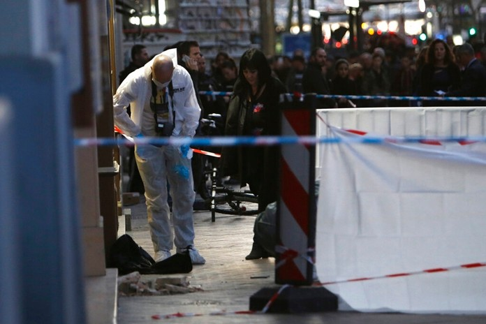 Investigating police officers work at the scene after an incident, in Marseille, southern France, Tuesday, Feb. 19. (AP Photo/Claude Paris)