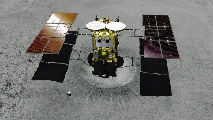 This computer graphic image shows the Japanese unmanned spacecraft Hayabusa2 approaching the asteroid Ryugu. (JAXA via AP)