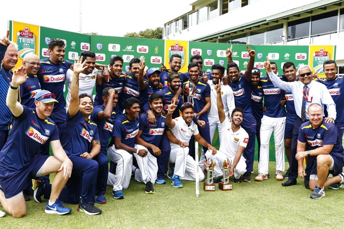 Sri Lanka's cricket team celebrates winning their two five-day cricket tests against South Africa at St. George's Park in Port Elizabeth, South Africa, Saturday, Feb. 23. (AP Photo/Michael Sheehan)
