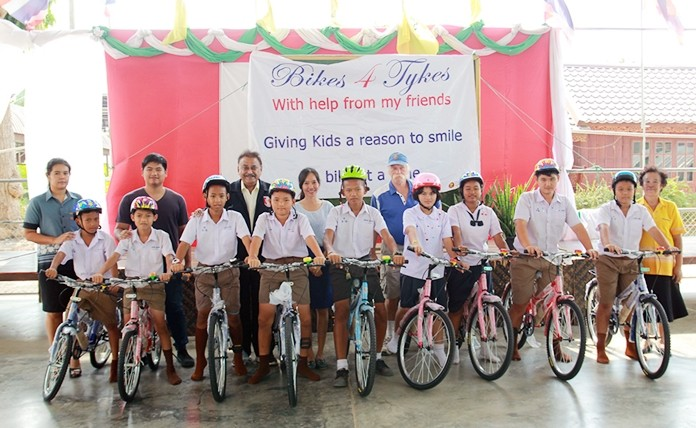 PSC President Peter Malhotra, accompanied by Bikes for Tykes founder Rick Bevington, and Sorapan Chawalitnititham from the Chor Namchai Shop in Naklua, present nine bicycles to students at Wat Nongketyai School.
