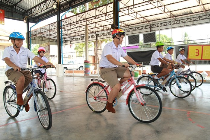 Children try out their new bicycles.