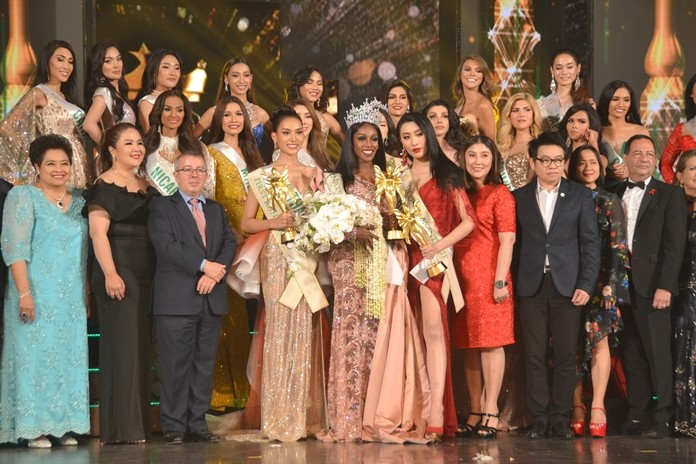 Winners and contestants pose on stage after the show with judges and sponsors of the Miss International Queen 2019 beauty contest at Tiffany Theater, Pattaya.