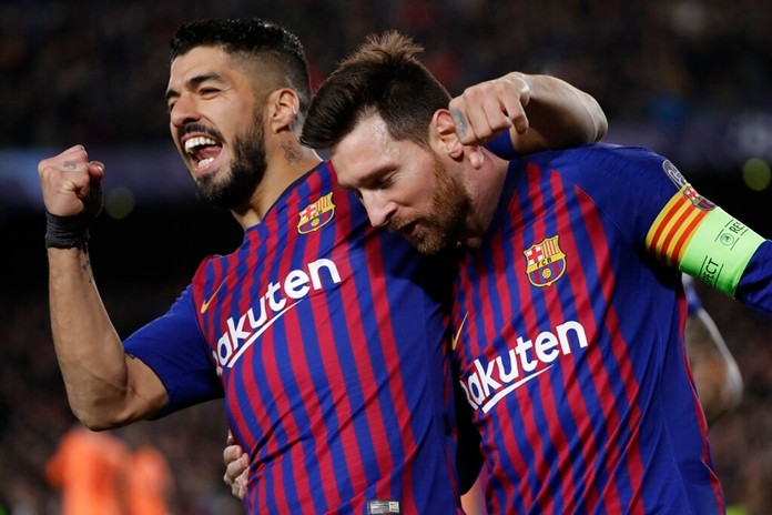 Barcelona's Lionel Messi, right and  Luis Suarez celebrate after Messi scored his side's third goal during the Champions League round of 16, 2nd leg, soccer match between FC Barcelona and Olympique Lyon at the Camp Nou stadium in Barcelona, Spain, Wednesday, March 13. (AP Photo/Emilio Morenatti)