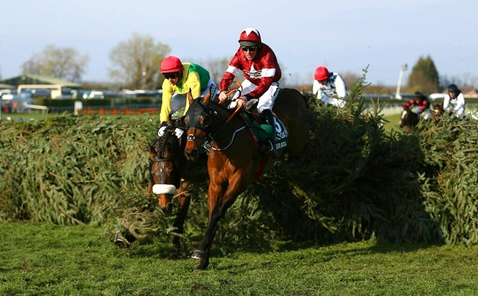 Tiger Roll ridden by jockey Davy Russell jumps a fence on the way to winning the Grand National Handicap Chase at Aintree Racecourse, near Liverpool, England, Saturday April 6, 2019. (Nigel French/PA via AP)