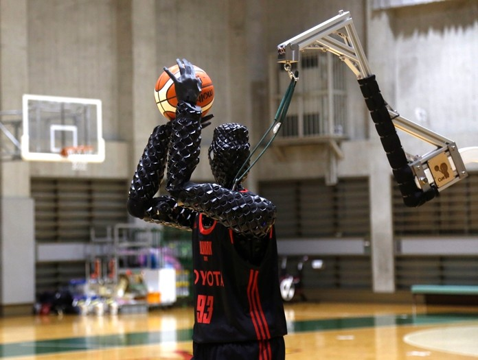 Toyota's basketball robot Cue 3, the 207-centimeter (six-foot-10) -tall machine made five of eight three-pointer shots in a demonstration in a Tokyo suburb Monday, a ratio its engineers say is worse than usual. (AP Photo/Yuri Kageyama)