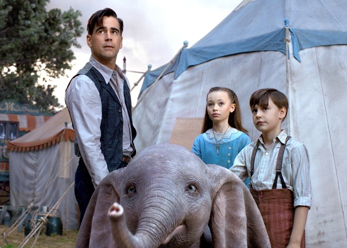 """This image shows Colin Farrell, Nico Parker and Finley Hobbins in a scene from """"Dumbo."""" (Disney via AP)"""