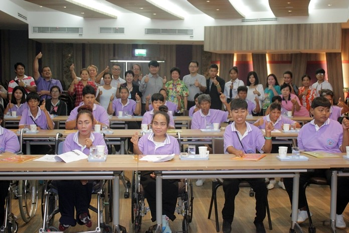 Social Welfare chiefs Pannee Limcharoe (back row, center) leads a seminar Pattaya hosted to boost self-esteem and improve the quality of life for the disabled.