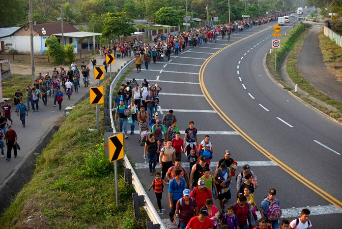 Central American migrants, part of the caravan hoping to reach the U.S. border, walk on the shoulder of a road in Frontera Hidalgo, Mexico, Friday, April 12. (AP Photo/Isabel Mateos)