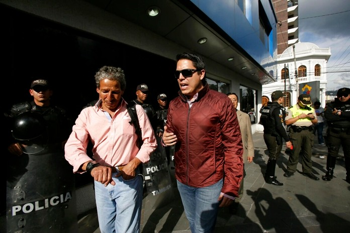 Ola Bini's lawyer Carlos Soria, right center, arrives at the Flagrant Crimes Unit where his Swedish client is being held in Quito, Ecuador, Friday, April 12. (AP Photo/Dolores Ochoa)