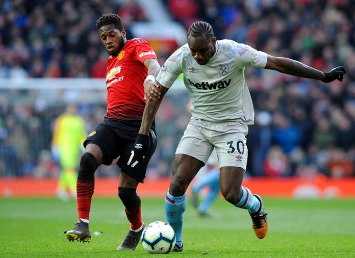 Manchester United's Fred vies for the ball with West Ham's Michail Antonio, right, during the English Premier League soccer match between Manchester United and West Ham United at Old Trafford in Manchester, England, Saturday, April 13, 2019. (AP Photo/Rui Vieira)