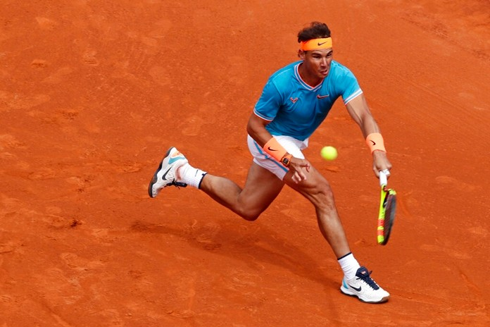 Rafael Nadal returns the ball to David Ferrer during their men's singles match at the Barcelona Open Tennis Tournament in Barcelona, Spain, Thursday, April 25, 2019. (AP Photo/Manu Fernandez)