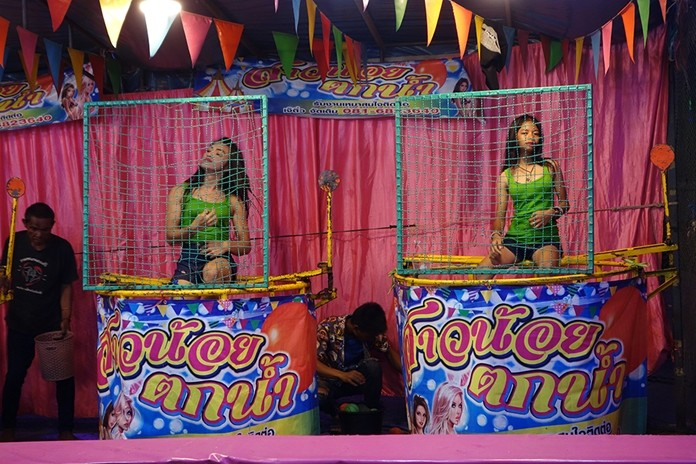 How's your aim? Dunk a girl for charity at the Chaimongkol fair.