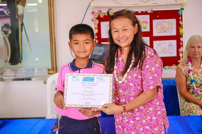 Winners of the school's art contest are awarded certificates.