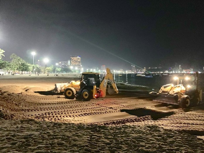 Crews work through the night to repair flood damage on Pattaya Beach.