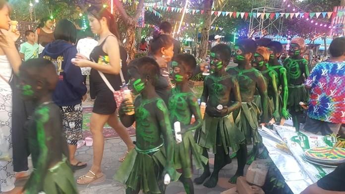Spirits eat sacrificial offerings provided by local residences at Lan Pho Public Park Naklua.