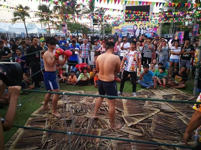 Muay Tub Jak, blindfolded boxing, gets the crowds' spirits up.