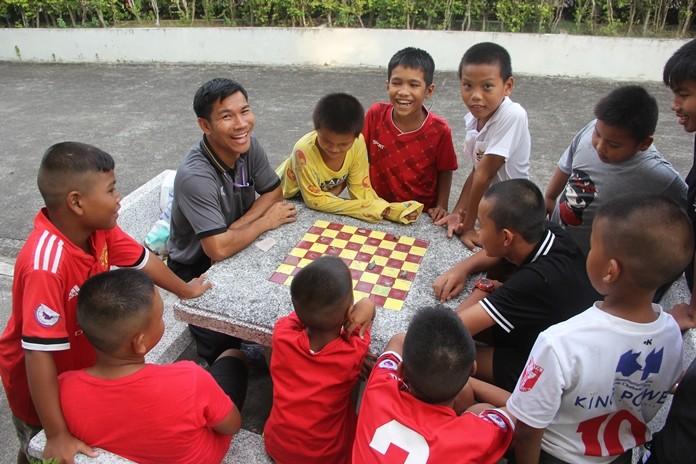 One teacher teaching the boys how to win.